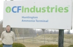 Brad Gordon, superintendent of the CF Industries Huntington Ammonia Terminal, poses with the facility's sign off Hosler Road outside Huntington on Tuesday, March 9. The terminal is a stop in distributing anhydrous ammonia.