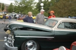Joe Bellinger (right), of Waterloo, talks about his vintage car with Sandy Smith (left) and Jim Starbuck during the Flashback to the '60s car show at Huntington University last year.