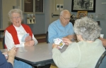 Mary Jane Thompson (left), Esther Hinen (back to camera) and Richard Newell play a hand of euchre on Monday, Jan. 3, at the Senior Center in Huntington.