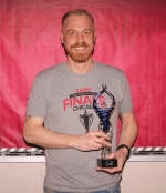 Aaron Childress, director of choirs at Huntington North High School, holds the Vocal Vanguard Award, which he won at the Aspire Awards on May 4, at Genesee Theatre, in Waukegan, IL. The Aspire Awards recognize the show choir industry's best and brightest members. The Vocal Vanguard Award is given to the nation's top director.