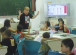 Dr. Susan Burson, an education professor at Huntington University, teaches a class at Yung Wing Primary School in Zhuhai, China, in July.