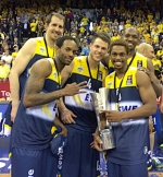 Chris Kramer (third from left), a star basketball player at Huntington North High School and Purdue University, poses with his teammates on the EWE Baskets, a professional basketball team based in Oldenburg, Germany, after winning the German Cup in April. Kramer returns to Huntington next week for a youth basketball camp, where all proceeds will go toward purchasing backpacks for local children.
