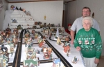 Hazel Ruth Brooks and her son Jerry Brooks stand with a portion of her Christmas village, which she plans to share with the community during an open house at her rural Warren home on Dec. 14 and 15.