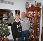 Phyllis and George Pieper, of Huntington, stand beside a display case in their living room containing a portion of their collection of Santa Claus memorabilia, which the couple estimates to be around 300 pieces.