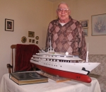 Bob Cline, of Huntington, stands with a model he built several years ago of the Trump Princess, a lavish yacht once owned by Donald Trump. Cline got to meet the future United States president and spend time aboard the yacht, which he counts among the highlights of a long and fruitful career in model-making.
