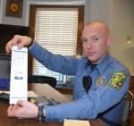 Greg Wajer, ordinance officer with the Huntington Police Department, displays the computer generated parking ticket that will soon begin appearing on the windshields of parking violators.