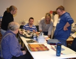 The men's sewing group at Creative Abilities Art Studio prepare fabric to be made into remote control holders. The group includes (from left) Harley J. Wolfe, assistant Tania Lange, Mathew Hartley, art director Sarah Schwab and Shawn Kelley.