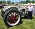 David Daugherty, president and chief executive officer of The Daugherty Companies Inc., in Warren, stands by a 1938 RC Case tractor, which was one of the first offered by the company when it opened in 1939. This year marks the company's 75th anniversary.