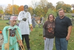 Barb and Wendell Koedel stand amidst the huge Halloween display in their yard at 1557 College Ave., preparing to receive Halloween trick-or-treaters on Saturday evening. This is the fourth year for the display, which grows bigger each year, they say.
