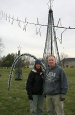 Tina and Bob VandenBoom take a moment from wiring a portion of the computer-operated light display at Zanesville United Methodist Church.
