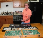 Sonya Harshman, of rural Andrews, shows off the collection of objects she found while using a metal detector. She has traveled to several states to enjoy her hobby, which has netted some important finds including a gold coin.