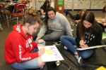 Huntington North High School students (from left) Morgan Murray, freshman; Kailey Kelley, senior; and Jayden Swihart, sophomore; put aside class differences as they work together on a Diversity Club project on Sept. 14 after school. The club, which explores diverse social cultures, welcomes anyone to be a member.