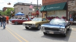 Rolling into Roanoke guests check out cars on display on Main Street in downtown Roanoke in 2018.