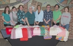 Students from the Huntington University Theater Department helped sew children's clothing for use in missions around the world. Pictured (from left) are Alyssa Plisco, Sarah Moloney, Alora Trinkle, instructor Mary Zellers, project coordinator Kris Hittler, Jordan Gregory, Trenidy Cox and Emma Fried. Students not pictured are CeCe Cherry, Karli Melder, Jessi Snyder, Cailin Fielding, Kaeley Osterman, Emma Slavin-Hall and Lauren Sowers.