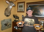 John Block, chairman of the Huntington Hills chapter of Ducks Unlimited, stands with the 1999 and 2000 Top Flight Awards the chapter received from the national DU organization in recognition of the chapter's fund-raising and involvement efforts.