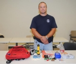 Brian Topp, deputy director of the Huntington County Emergency Management Agency, stands by items in an example emergency kit. September is National Preparedness Month and the EMA is encouraging Huntington County residents to prepare for disasters.