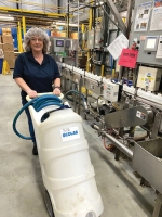 Ecolab employee Angie Bartrom prepares a production filling line at the Huntington plant. The company reports it has had between a five and seven-times increase in demand for its products since the COVID-19 pandemic began.