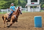 "Sixteen-year-old Emily Freise, of Majenica, runs a barrel pattern with her horse, ""Jaguar's Blazing Coco,"" or ""Jag"" for short, at the Chief LaFontaine Saddle Club, in Huntington. In addition to being a horse trainer and riding instructor, Freise competes in the rodeo event of goat tying and currently holds the top ranking nationally in her age range."