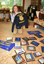 Kathleen Jacobs displays just a few of the many awards and acknowledgments she has received during her time in the FFA. She estimates she has received about 40 awards, including a national FFA award for extemporaneous speaking.