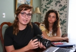 Olivia Henderson (left) holds the camera she will use as she and Alyssa Woolard go over a storyboard for the film project they are working on in Henderson's home on July 13. The two Huntington North High School students recently attended a film camp at Anderson University.