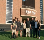 Huntington native Matt Folk (seventh from left) stands outside Folk Field, the home of Purdue University soccer, alongside family members earlier this year. After making a generous donation to the school's football and soccer programs, he was given the opportunity to rename the soccer field and did so in honor of his father and mother, Loren Folk and the late Donna Folk. With Folk are (from left) Walker Mattice, Brooks Mattice, sister Jennie Folk Mattice, Reagan Mattice, stepmother Dianna Folk, Loren Folk, wife Mary Folk and Naomi Henn.