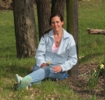 Taking advantage of the wooded property at her parents' home on Rangeline Road on April 12, Christy Thomson demonstrates how taking time to sit and take in the sights, sounds and scents of the woods can help hikers relax and reap several benefits to their physical, emotional and spiritual health.