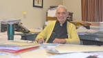 Rev. John Pfister, a Huntington native who returned to his hometown to serve as pastor of St. Mary Catholic Church, will retire this month after 49 years as an active priest. He's seen here in his office at the rectory, next door to the church.