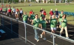 Employees of area businesses participate in last year's Battle of the Businesses Fun Walk, held at Kriegbaum Field. The program, sponsored by the YMCA and Huntington Parks Department, features numerous events over three weekends