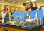 Riverview Middle School eighth grade students Amara Eckert (left) and Olivia Rosen practice their presentation of the future they have created, Hydrophageopolis, shown in model form in preparation for the Future City Competition regionals on Saturday at Indiana University-Purdue University, Fort Wayne.