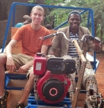 Jordan Garrity (left) sits in the passenger's seat as Arsene, an employee of the non-profit ACREST in Cameroon, test drives one of the AgRovers that Garrity's company hopes to manufacture in several countries in Africa.
