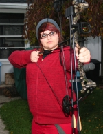 Jade Miller, 13, concentrates as she practices with her new compound bow in the backyard of her home in Huntington. She plans to hunt deer with her father and brother during the 2014 archery season.