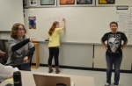 "Adrianna Collins, (center) secretary for the Huntington North High School Anime Club, spells out ""Senbonzakura"" during an anime-themed spelling game on Wednesday, March 16. Club Treasurer Trystin Godfroy (left) and President Janessa Dodson moderate the game."