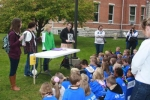 Huntington University students teach children from Noble County Schools about Pocahontas  at a history department station during the Walk into My Future event sponsored by the Noble County Promise at Huntington University on Oct.1.