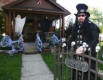 """Rich Sutton, aka """"The Prince of Darkness,"""" welcomes visitors to his home at 954 Poplar St., Huntington, which has been transformed into a ghoulish graveyard."""