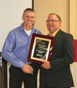 Huntington North High School math teacher and baseball coach Jarod Hammel (left) receives the Huntington County Community School Corporation's 2016 Teacher of the Year award, presented by HCCSC Superintendent Randy Harris on Wednesday, May 25, during the Huntington County Community School year-end breakfast and awards ceremony, held at Huntington North High School.