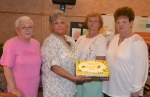 Officers of the Happy Grandmothers Club prepare to celebrate the club's 63rd birthday on Monday, May 18, during a dinner in the Parkview Huntington Hospital cafeteria. The officers are (from left) Kathy Bogert, president; Rosa Van Ness, secretary; Shirley Love, treasurer; and Bev Burkhart, vice president.