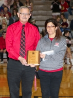 Huntington native John Harrell (left) stands with a plaque presented to him by Huntington North High School athletic director Kris Teusch commemorating his status as the recipient of the 2016 Indiana Fever Silver Medal Award. The award, which is handed out by the Indiana Basketball Hall of Fame, recognizes outstanding contributions made to high school basketball by someone other than a player or coach. Harrell, the founder of JohnHarrell.net and a longtime sportswriter, received the plaque during a basketball game at HNHS on Feb. 26. He will be inducted into the hall of fame at a ceremony in Indianapolis on April 30.