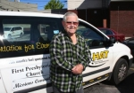 David Spencer stands next to his familiar HAT van. The popular driver retired on Friday, July 18, after 19 years of service.