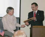 """Jim Miller (left) was presented with the """"Hometown Hero of the Year,"""" award by Mike Rohler, executive director of the Huntington Chapter of the American Red Cross on Saturday, March 6."""