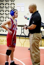 Ray Houser (right), a coach for the Crestview Middle School wrestling team, gives some instruction to wrestler Riley Bowman during a meet. Passionate about coaching, Houser has called the shots for numerous teams in a variety of different sports through the county.