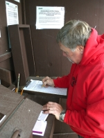 Gary Hunter, a Wabash County resident who lives near Salamonie Reservoir, signs in at Sign-in Station No. 2 at Salamonie Reservoir on Friday, Nov. 5. Firearm deer hunting season is set to begin this weekend.