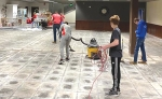 Huntington North High School's Junior Reserve Officers' Training Corps (JROTC) students donated their time to a local church and café, first taking down Christmas decorations and then using a shop-vac to prepare the floor for renovations.