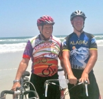 Stan Bippus (left), and his nephew Jeremy Winkelman (right) stand with their bikes on the Atlantic coast in St. Augustine, FL, on Saturday, May 22, after finally completing a cross-country bike ride despite two major accidents.