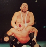 "Huntington native Kasey ""KC Thunder"" Geyer (top), pictured here in the early 2000s taking on Yuto Aijima in a professional wrestling match in Tokyo, Japan, is returning to his hometown for ""Christmas Clash 2016,"" a pro wrestling event on Saturday, Dec. 10, at the Police Athletic League Club. The match will be Geyer's first in several years and marks the second comeback of his career, which has spanned over 20 years."