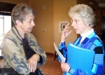 Sister Rose Ann Kaiser of Victory Noll (right) speaks with an associate, Mary Alice Kelly, earlier this year at a meeting in Colorado.