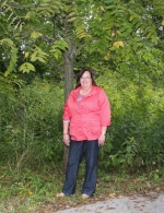 Amy Silva, Little River Wetlands Project new executive director, stands on part of the 53 acres that make up Little River Landing - a preserve owned by LRWP and ACRES Landtrust in Huntington County.