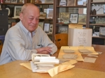 Don Swank is surrounded by letters written by World War II soldiers to his dad, Gerald Swank. All of the correspondence is being preserved on a statewide website and many of the original letters have been returned to the writers' families.  Swank is still trying to locate families of several of the letter writers.