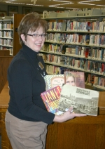Jan Carnes, head of adult services at the Huntington City-Township Public Library, displays books that made the frequent check-out list at the library for 2009 on Thursday, Feb. 4. While some genres enjoyed continued popularity, others sank or rose.