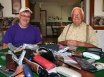 James Vachon (left) and James Coppock of the Roanoke Lions Club prepare to pack up a table-full of about 100 eye glasses in support of the Lions Club's program to donate glasses to help improve the vision of low-income and poor people.