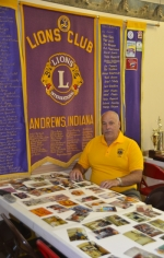 Mike Okuly, a board member and officer for the Andrews Lions Club, assembles photo montages to be displayed at the club's 70th anniversary open house on Saturday, June 13, from noon to 3 p.m.